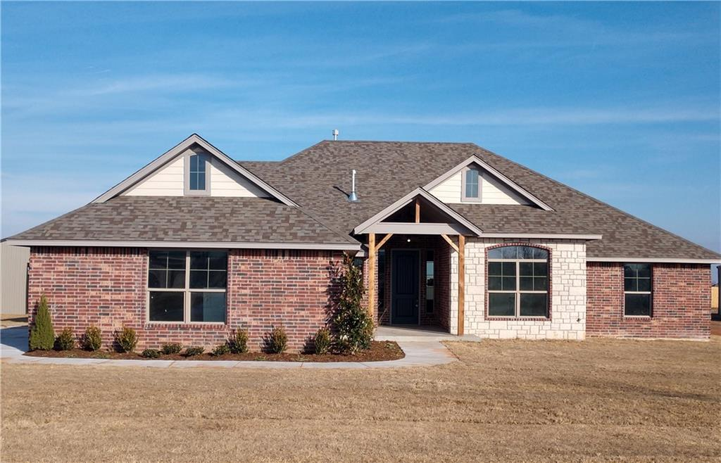 OKC's award winning builder, Blue Ribbon Construction, does it again! This gorgeous new home offers flexibility, convenience and storage. Built on nearly 3/4 acre with a 30x40 shop building included! Able to accommodate up to 4 bedrooms, two living areas or a study this home offers all the modern features such as wood look tile, crown molding, eat in kitchen, contemporary finishes and walk in pantry. Outstanding master suite includes a spacious owners closet with direct access into the utility room. Across the home, two guest bedrooms share a large bath with dual vanities and linen storage. In addition, the 11'X14' flex room can accommodate a variety of needs, such as 4th bedroom, office or den. Located in a rapidly growing area of the metro, own your piece of the country with shopping and dining just minutes away.