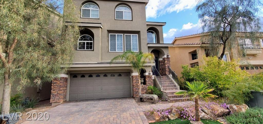 Stunning 3-story American West home in Southwest Las Vegas. New backyard landscaping with real grass, and flowerbeds. Immaculately kept home with 4 beds, 3 full baths, one half-bath, and a separate master with ensuite bathroom downstairs.