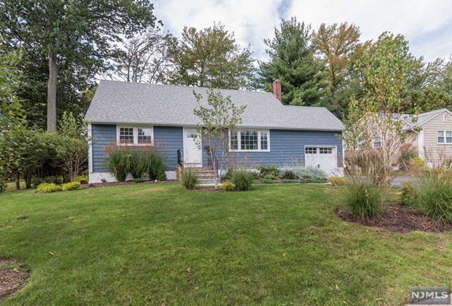 DESIRABLE QUIET STREET LOCATION FOR THIS UPDATED 4 BEDROOM CAPE! ALL NEW IN THE PAST YEAR: SIDING, WINDOWS, ROOF, DRIVEWAY, SIDEWALK, PATIO AND EXTENSIVE LANDSCAPING. RENOVATED INTERIOR FEATURES BEAUTIFUL NEW KITCHEN WITH STAINLESS APPLIANCES AND AN ISLAND WITH SEATING. EASY ACCESS TO THE PATIO FROM KITCHEN FOR OUTDOOR DINING. NICE, LEVEL BACKYARD HAS RETRO CHARCOAL BBQ STATION. FINISHED BASEMENT IS BRIGHT AND OFFERS MANY POSSIBILITIES. THERE IS A FULL BATH ON EACH LEVEL OF THIS HOME. GREAT NEIGHBORHOOD, WONDERFUL COMMUNITY AND SCHOOLS!  TURN KEY, MOVE-IN CONDITION.