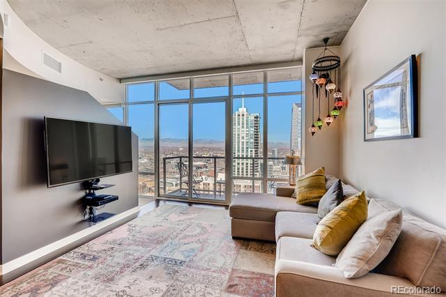 COMPLETELY FURNISHED 1-BEDROOM + DEN SPIRE CONDO HAS MIND-BLOWING VIEWS OF DENVER-- SPECTACULAR MOUNTAIN VIEWS AND UNBELIEVABLE CITY VIEWS!! This 38th floor home features dramatic floor-to-ceiling windows, loft-like design, stainless steel appliances, slab granite counters, hardwood floors throughout much of the condo, parking space in the attached garage and storage. Den has a Murphy bed, perfect for overnight guest. Custom paint, motorized shades and wall mounted TV's. The 42-story SPIRE is LEED-certified, with 40,000 sq ft of awesome amenities, including a rooftop pool which is heated & open year-round, two hot-tubs, extensive health club, This home comes with access to the 42nd floor SkyClub. Outdoor grilling area, 10th-floor private event lounge, 24-hour courtesy desk, fully-furnished SPIRE guest suites, with modern security & access control systems. Ready now! Just bring your clothes. All utilities $150/mo. Come home to Downtown Denver's SPIRE -- life is better here!