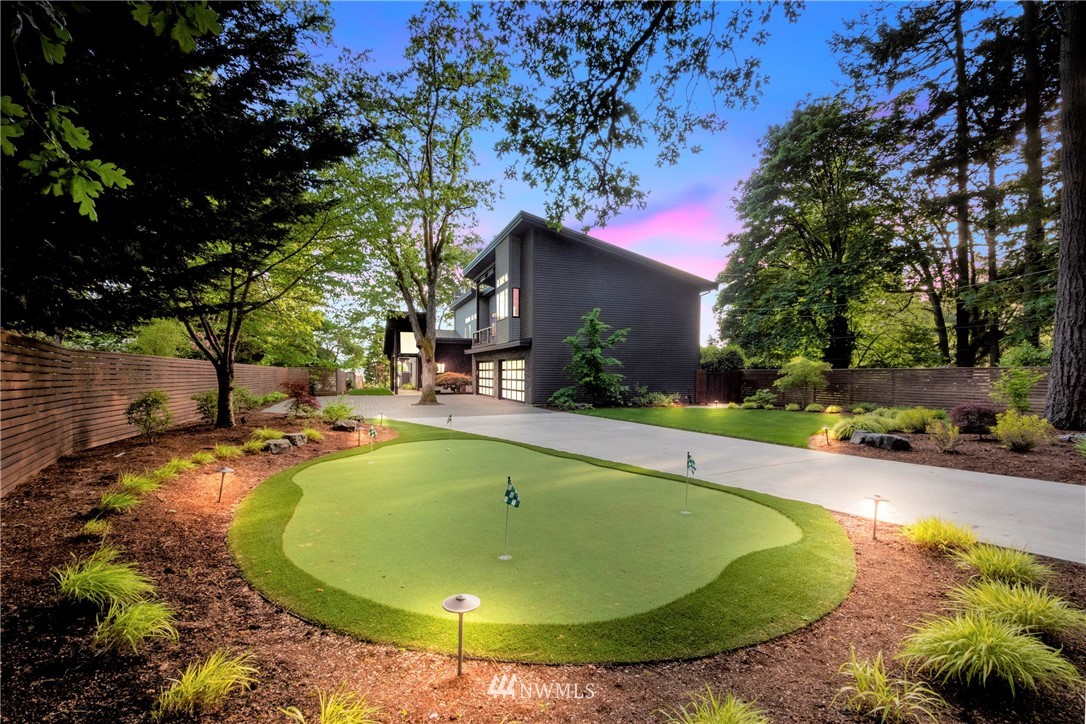 Unparalleled Modern masterpiece brimming w/ chic casual luxury on American Lake just steps from Tacoma CC!   Dramatic gates open to reveal this astonishing, one of a kind abode, where creative exceptional elements envelope every space.  Formerly the home of PGA star Ryan Moore, now elevated to pure perfection to even include a 4 hole putting green!  Exotic stone & hardwoods, heated concrete floors, Walnut cabinets, Nano-walls, 4 fireplaces, 2 master suites, theater, beach cabana, firepit, dock