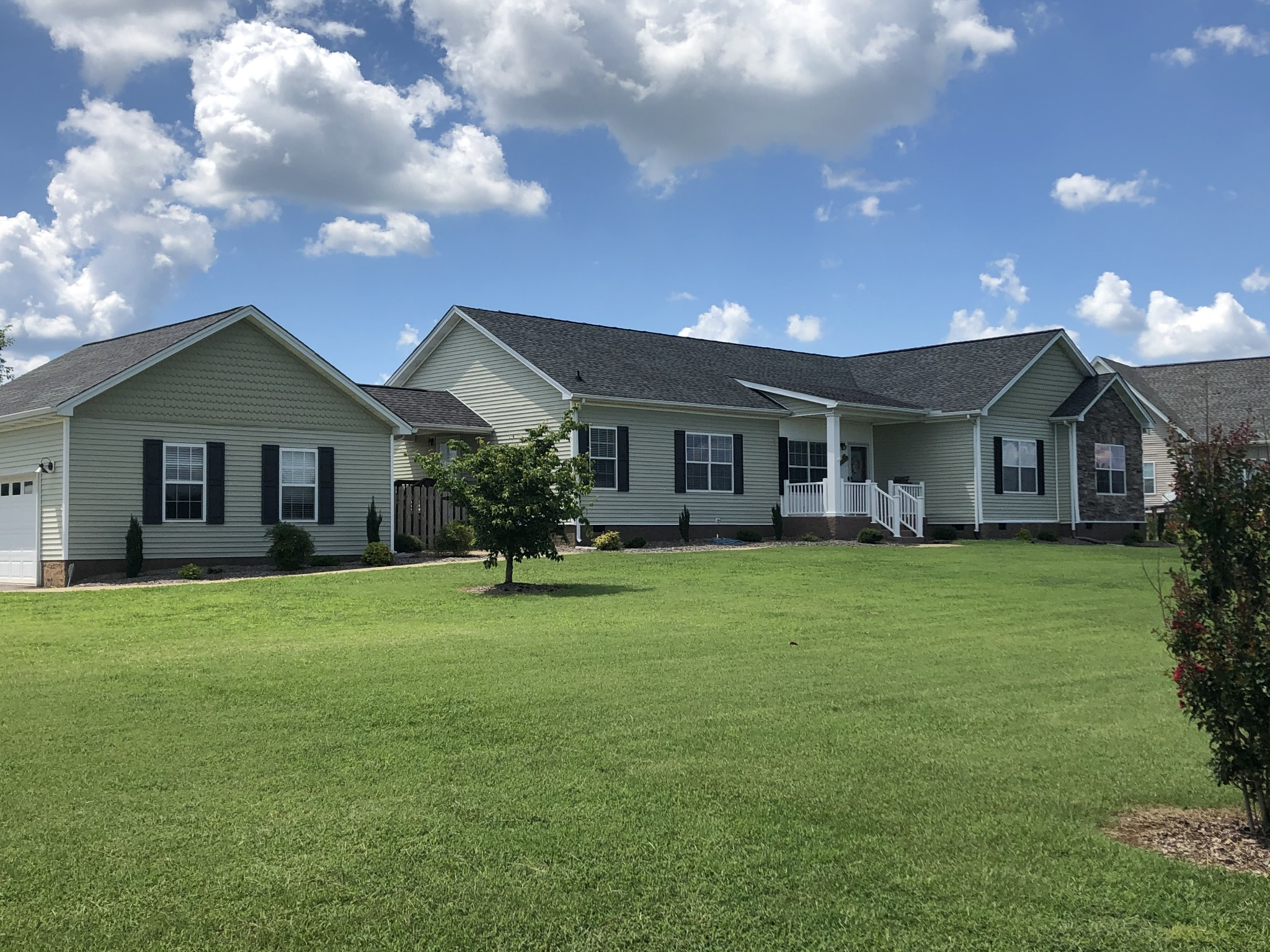 Beautiful home on 1 Acre,  MANY Upgrades, 9' Ceilings, Crown Molding, One level, 3 bdrms 2.5 baths, side entry garage, privacy fence, breezeway, covered front & back porches. Spacious Kitchen w/Island, X-tra large Master suite w/walk-in closets. Private office/art room. New paint, fixtures, flooring 2017, Country living, 5 miles to Kroeger, I-65, Saturn Parkway. Close to shopping & GM Plant. Room for gardening & park the RV. NO HOA!  Chicken coop stays, play gym does not remain.
