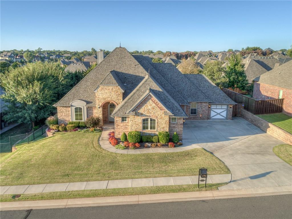 A quintessentially well-rounded home in Edmond's own Iron Horse Ranch community. The layout opens from the foyer to the main living room with large picture windows on one wall and a beautiful fireplace with built-ins on the other.  To the side of the entrance, a formal dining room, as well as a study, are perfectly positioned and can flex for other needs as well. This is a great floorplan to get creative with your space and room requirements. It even has an expansive upstairs bonus room with bathroom to accommodate. Fresh and meaningful updates have been made to the home, giving it a current yet inviting design. You'll love the kitchen and breakfast space with views to the living room over a raised bar with seating. A small center prep island and walk in pantry complete the kitchen perfectly! The master suite is also a real treat with a beautiful tiered ceiling and well-appointed master bathroom- ready to meet your R&R needs every day in style. Gated community with all the extras!