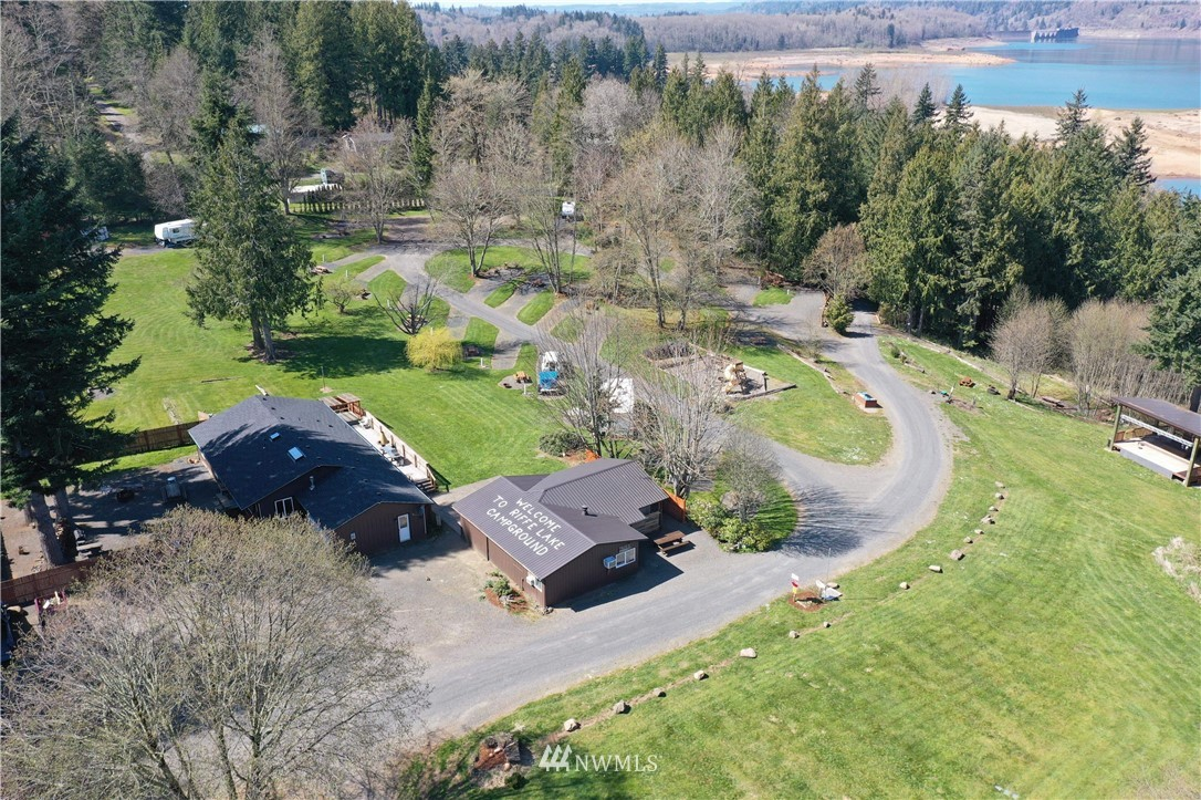 Established campground, two homes, office and store, cabins and RV spaces. 24 x 36 Gen per building for equipment and a stage for entertainment. This busy campground has become well know for RIFFESTOCK music festival in the last few years.please refer to supplements for details.