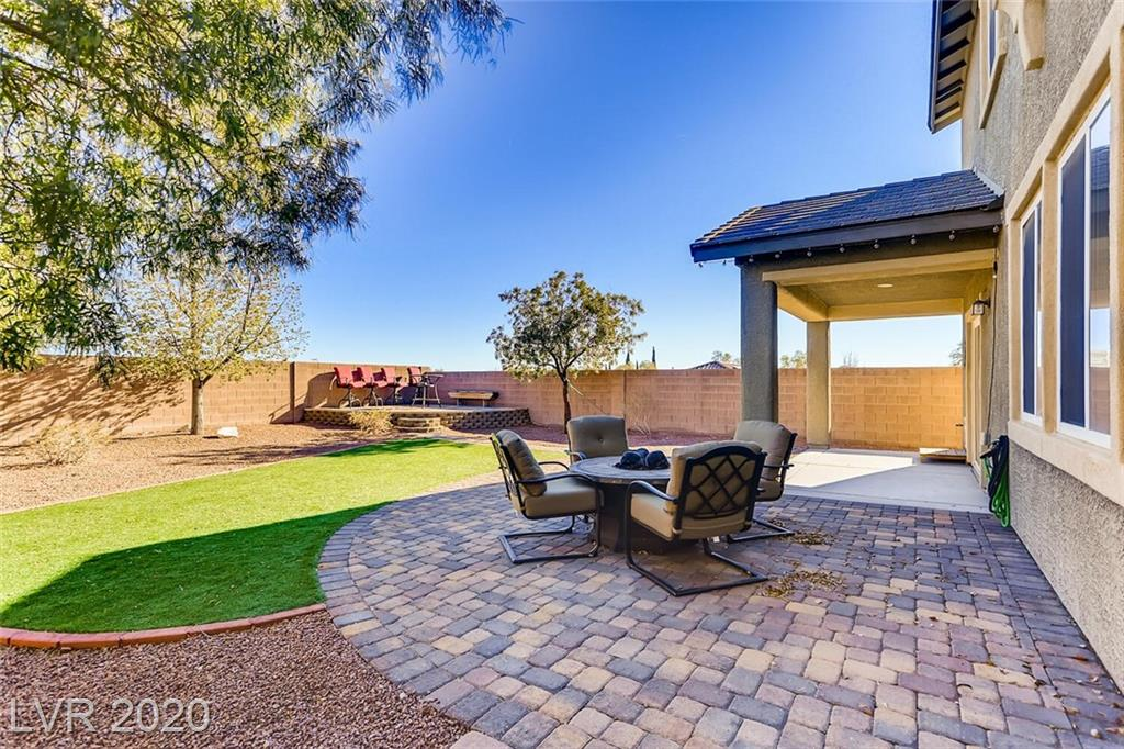 Built in 2011, this open and spacious corner-lot home located in the Master Planned community of Providence comes beautifully landscaped and boasts strip and mountain views. It features four bedrooms up and a bonus Room/Den down. The kitchen has a large walk-in pantry, granite counters, an island, stainless appliances, and ample cabinet space.  The three-car tandem garage has a side yard access door and is where you will find the included water softener, and water heater.  All bedrooms are located upstairs along with a standalone and sizeable laundry room.  The Master bedroom/bathroom has a large walk-in closet and a separate bath/shower with dual sinks.  This upgraded home has tile and wood like flooring throughout. Very easy access to the 215 highway, as well as newly developed shopping nearby.    Additional Features include the already Installed pet door, Surround Sound speakers, BBQ Gas Stub, home networking box, and much more.