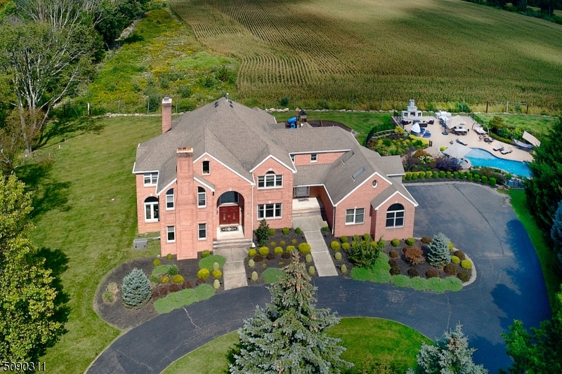 Luxurious Country Living at its Finest! Just Imagine the Entertaining Possibilities! Introducing Brick/Clapboard Custom Colonial Residence w/resort/club style flair, presenting 4 bedrooms, 4.5 baths, finished daylight- walk-out lower level, gunite saltwater pool, water fall, diving rocks, hot tub, a fully-equipped outdoor kitchen and stone fireplace, patio & 2016 wrap-around entertainment decking set on two plus landscaped, cul-de-sac acs, backing to a 100+ acre farm, w/endless panoramic pastoral views. 1994 young w/premium updates to 2016, built-in generator, $100K Control 4 Smart System, Nest &Tesla Chargers & 3 car garage, this Modern 4400 sqft home at Hook Mountain Estates has it all! Highlights: wood, stone and tile floors, 4 fireplaces, soaring ceilings, distinctive moldings, multiple skylights, French doors, transom-topped windows & glass doors, 2017 Andersen windows & doors, towering two-story foyer, fireside library, dining room lined in exquisite millwork, two story great room anchored by a floor/ceiling, stone wall fireplace, inviting conservatory w/window wall topped by half-moon windows, a remodeled 2014 chef's center island kitchen finished in cherry, granite with premium s/s appliances & windowed breakfast area, a primary suite w/renovated lux spa bath, spacious secondary bedrooms & baths, finished day-light, walkout low level for casual entertaining in the home theater, expansive windowed billiards/recreation/game room, office & full bath. Interested?