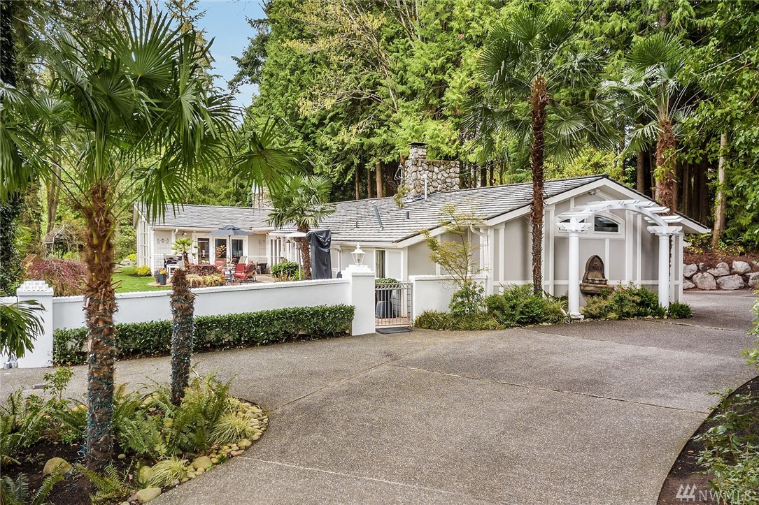 Magical Bellevue Oasis - unlike any other offering w/ over an acre of majestic grounds. Less than 1 mile from downtown - streams, ponds, waterfalls, evergreens. Saunter through verdant grounds by stepping stones, wooden steps & rustic bridges. Romantic country home w/ storybook 3,485 SF rambler + charming cottage. 4BRs, 3BAs w/ views of gorgeous vistas throughout. Open plan w/ outdoor & patio access. Unmatched views & unbeatable charm. Escape the city to this private sanctuary!