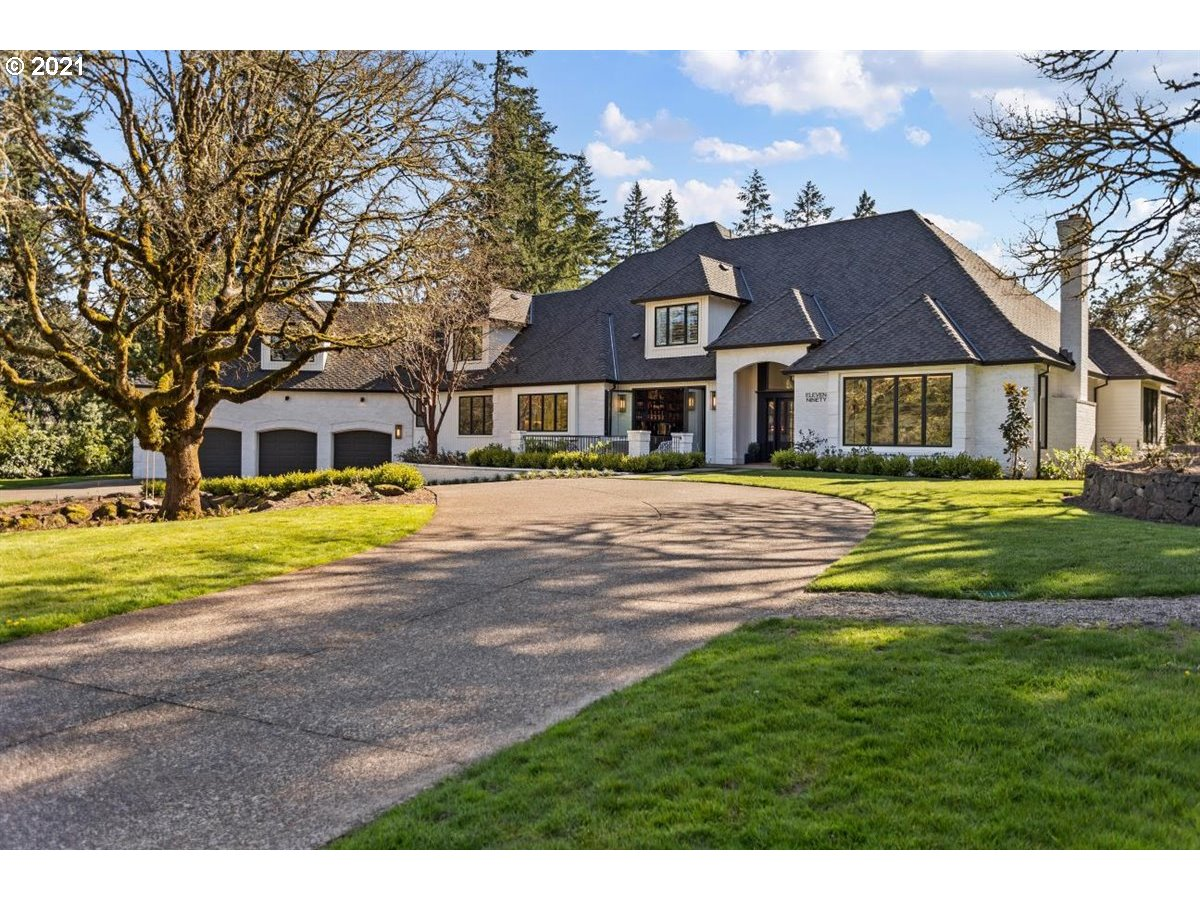 A very rare find; 2.25 private, level, usable acres in one of LO's hottest locations w/golf course frontage & a private resort like setting. Fully renovated to perfection this property has what every other desires; main floor living, great room concept, bar that opens to a patio/fire pit w/views of 5 fairways; a totally private back yard w/2 outdoor covered areas; fire pit, pool/hot tub & acres to roam. Nothing was overlooked in the creation of this estate. Home comes w/automatic Lake boat slip.
