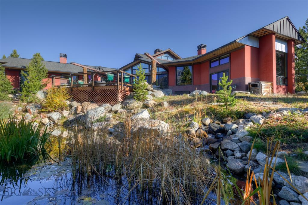 With easy ski access and panoramic Lone Mountain views, this gorgeous custom home is located on a 1.5 acre property in Cascade Highlands. The groomed ski trail runs right past this furnished home which offers primarily one level living with large windows in every room of the home, a pond and circulating stream in the backyard, a large back patio and deck, a hot tub, and a free standing sauna. The main home enjoys 5 bedrooms, 5 baths, a large family room, and a circular loft sitting area. The ADU can be accessed either through the garage or through a private entrance (along with a private driveway area), and offers 1 bedroom, 1 bathroom, a living room, a dining area and a kitchen. Unique architectural details abound in this spectacular Big Sky home! Updated Professional photos coming soon as kitchen, master bath, ADU, and back deck have been updated/added. See VRBO#267407 for additional photos.