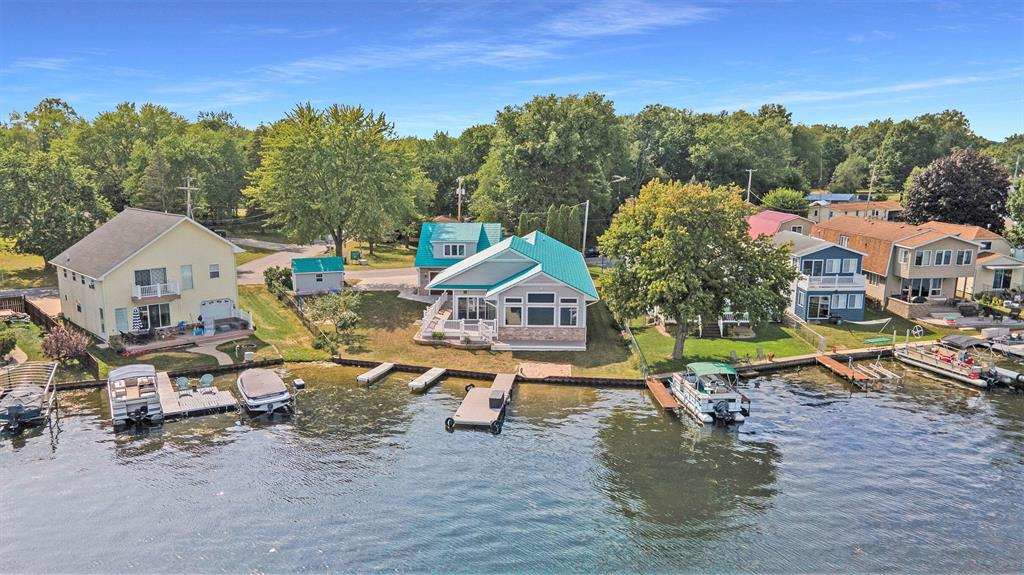 EXTRAORDINARY LAKEFRONT ON MICHIGAN CENTER CHAIN OF LAKES!  Top of the Line Amenities throughout this 2017 New Build! No Maintenance Exterior with Metal Shaker Roof, Vinyl Siding, Natural Stone Accent, AZEC PVC Trim and Wrap around Decking. 75 ft of Sandy Level Lakefront! Breathtaking Views of the Lake. Vaulted Ceilings in Living/Dining rooms. Radiant Floor Heat with Luxury Waterproof Vinyl Flooring. Stunning Kitchen with Soft Close Cabinetry, Granite countertops, an enormous Butlers Pantry, Island, Eat-in space and the most Amazing Stainless Steel Appliances featuring an Induction Stovetop!  5 Spacious Bedrooms including Master Suite and Bonus Room, one could be used as office or Rec Room! Four Bathrooms, 2 Full, 2 Half. Dedicated Hot Tub Room. Oversized Heated 2+ Car Garage! CALL TODAY!!