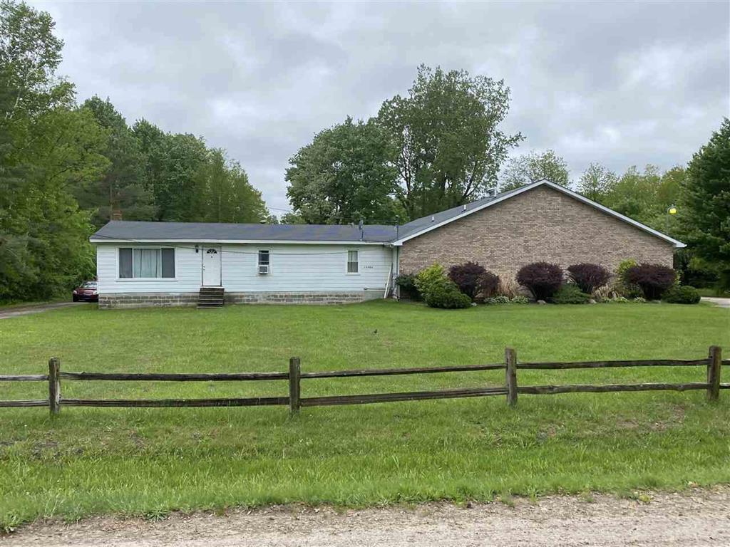Check out this one of a kind unique property!  This is a three bedroom ranch style home on 5 partially wooded acres with a 50'x80' (4,000 sq. ft.) addition, for a total of over 5,400 Sq. Ft.  that is currently being used as a banquet center which has been completely remodeled, including an all new HVAC system, new carpet and paint, new ceramic tile, and new large kitchen area, new foyer and serving area.  Also featuring Men's and women's restrooms, shower rooms, and two large storage rooms with outside entrances.  The main banquet room features vaulted ceilings and a large stage area.  This property also has ample parking on an asphalt parking lot and has a large grass area for additional parking or recreation.  Use your imagination!  There are so many possibilities with this property.