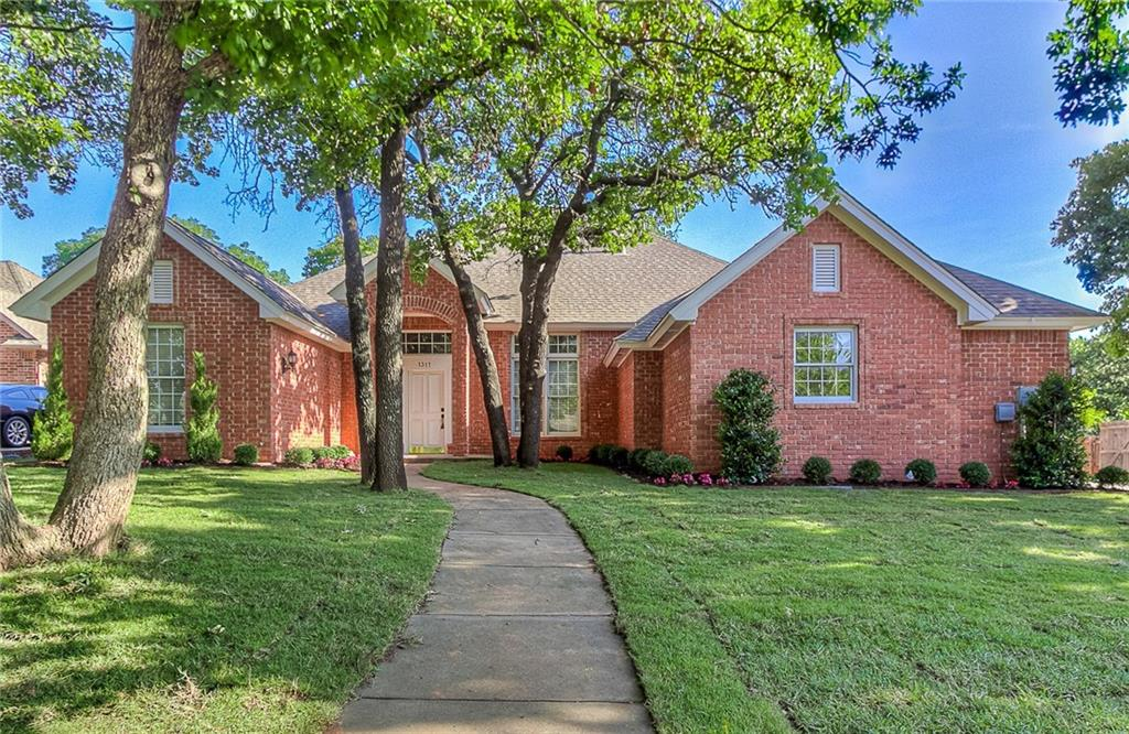 This must see home in ever popular Oak Tree Park has been freshly remodeled and features space for everyone! Wood floors lead you past the formal dining room and study into the secondary living area. The kitchen has all new stainless steel appliances and is open to the main living room with fireplace. The over sized master bedroom features a gorgeous new shower, jetted tub and walk in closet. An ensuite bedroom is located close to the secondary bedrooms that feature a jack n jill bath. A powder bath is located close to all of common areas and the large laundry room is nearby as well. The backyard features mature trees and plenty of space. Oak Tree Park features a pool, playground, tennis court and ponds as well and is located close to Cross Timbers Elementary School.