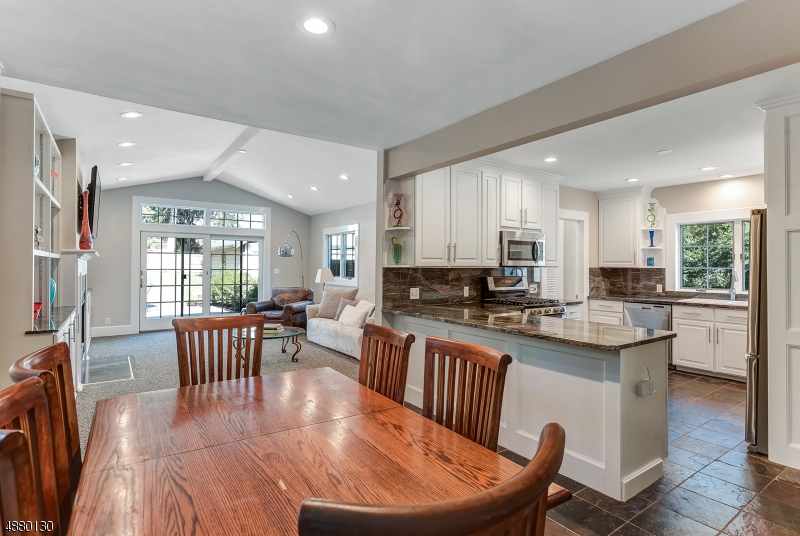 Incredible opportunity to own this dream home w/ 5 Bdrms, 4 Full, 2 Half Bth w/ excellent flow. Outstanding details w/ newly refinished wood floors, recessed lighting & crown molding throughout. Elegant Living Rm flows to a majestic study w/ NYC views. Gourmet Chef's Eat-In Kitchen w/ cust. cabinetry, granite counters & backsplashes opening up to the MOST fabulous vaulted ceiling Family Rm.  A formal Dining Rm & 1st flr Laundry complete the first level. Exceptional Master Suite w/ a stunning Master Bth w/ designer finishes +3 add'l Bdrms & two full baths. Third level offers a private suite w/ separate living area & full bth. Great layout for short or long-term guests. Finished LL w/ Rec. Rm is perfect for add'l activities. Easy access to downtown, top rated schools & midtown direct trains to NY.
