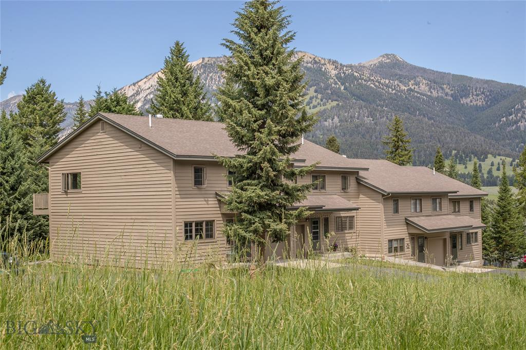 Hidden Village is appropriately named as it is quietly tucked in the trees very close to Big Sky's Meadow Village and the myriad of activities, dining and shopping in the Town Center.   This 3BR/2.5BA unit is in a great location as not only is it an end unit but it is quite near the community outdoor pool and hot tub.   This condominium has been lovingly cared for and comes furnished.    This unit has the very desirable Gallatin floorplan which has a really nice master suite on the same level as the living & dining areas and kitchen.   There is a single car attached garage with extra room to store the toys you need for an active lifestyle.    Hidden Village has a terrific outdoor pool, hot tub and club house and the HOA takes care of the exterior maintenance.   Turn key!