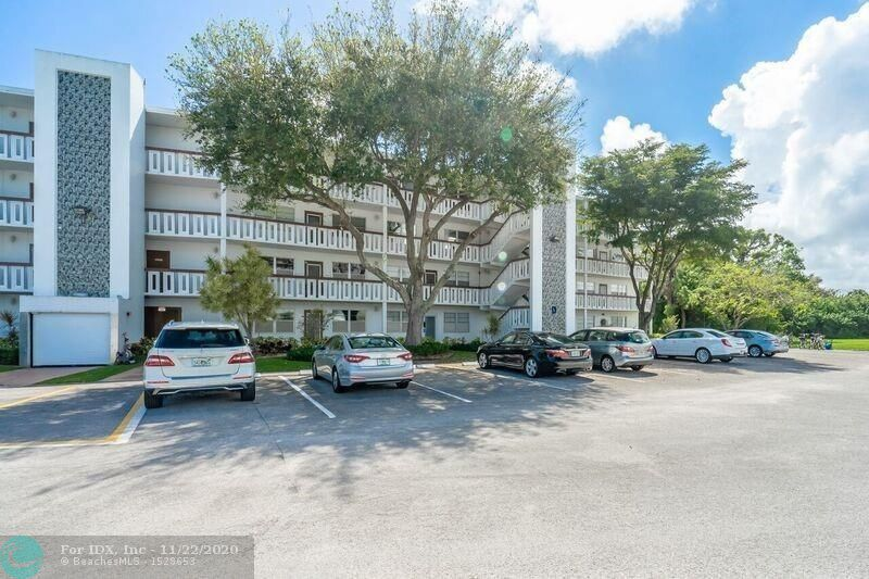 TOP FLOOR CORNER W/OPEN & QUIET PRESERVE VIEWS! THIS CONDO HAS MORE THAN YOU CAN IMAGINE! FULL HOUSE WATER FILTRATION SYSTEM INCLUDING FILTERS AT FAUCETS, SHOWERS & KITCHEN! BRAND NEW HOT WATER HEATER! PROFESSIONALLY PAINTED W/AURA LOW VOC PAINT, IMPACT HURRICANE WINDOWS & A/C ENCLOSED BALCONY! REMODELED KITCHEN FEATURES GRANITE W/GLASS BACKSPLASH, STAINLEES STEEL APPLIANCES, TILE FLOORS, BUILT IN PANTRY & WINDOWED BREAKFAST BAR! PANEL INTERIOR DOORS, TOMMY BAHAMA & MONTE CARLO CEILING FANS, TIFFANY STYLE GLASS CHANDELIER IN DINING AREA! FANTASTIC RESORT STYLE CLUBHOUSE. HEATED SATELLITE POOLS, FITNESS CENTER, THEATRE, LOTS OF ACTIVITIES PLUS COURTESY BUS INCLUDED! BEAUTIFULLY MAINTAINED CONDO BY EVIRONMENTALLY CONSCIOUS OWNER!  MUST SEE ALL THAT CENTURY VILLAGE HAS TO APPRECIATE!