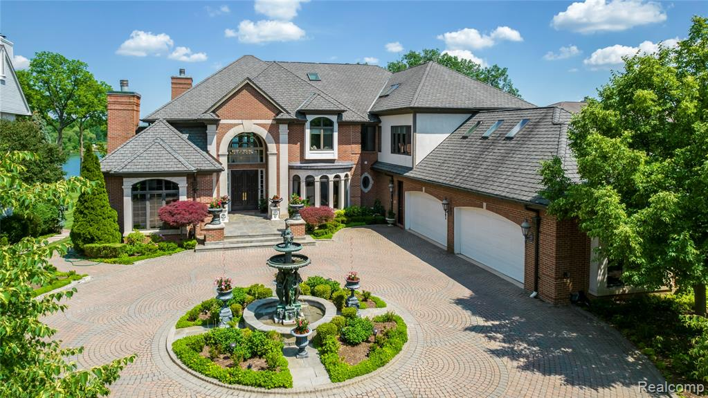 1.76 acres of impeccably landscaped waterfront grounds. Grand entrance with marble foyer, soaring ceilings and panoramic east-facing views of the all sports Walnut Lake. Gourmet granite kitchen with every amenity. Cherry wood library with built-ins and detailed hardwood floors. 6 fireplaces throughout.Jaw-dropping master suite feat. a separate seating area with 180° views, ensuite bathroom w/ large jetted tub, and his & hers walk-in closets. All bedrooms are suites with vaulted tray ceilings. Lower level includes: full kitchen, audio visual system w/ drop down movie screen, billiard room, workout space, & full glass spa room w/ lake views. Enjoy outdoor living & entertaining on the exquisite balcony and multi-level laid brick patio. Large heated 4 car garage. Birmingham Schools. Contact Renee today toschedule your privateshowing! 24 hr notice, proof of funds and pre-approval all required before private showing schedule will be confirmed.