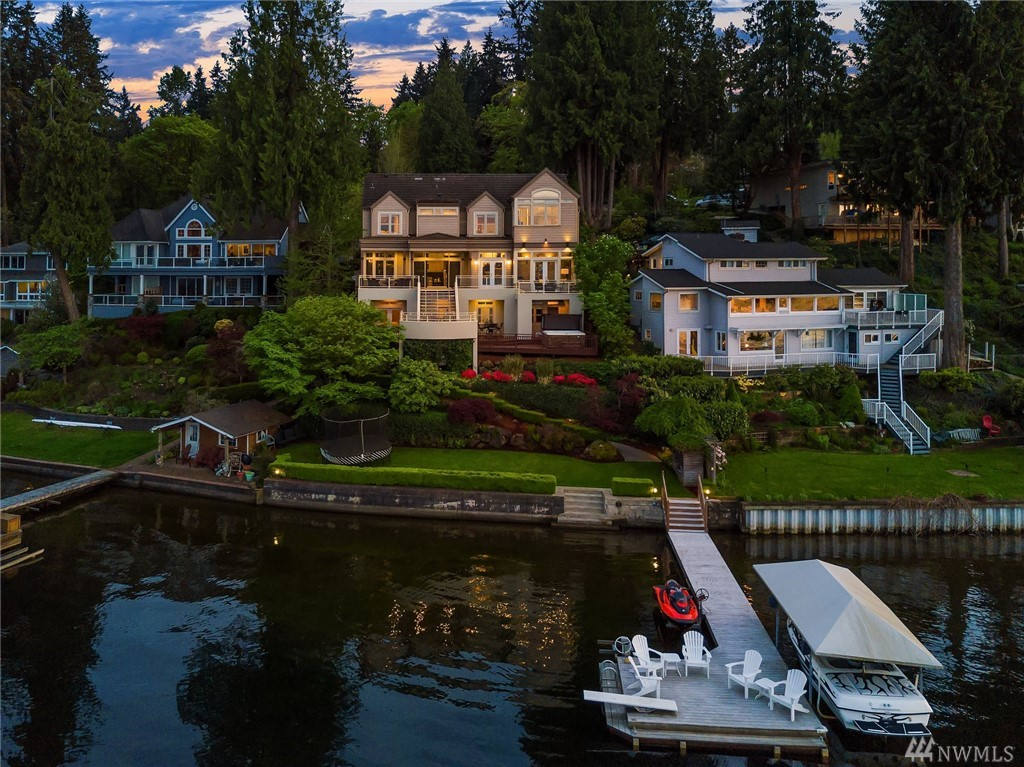 Enjoy commanding views from every room of this Lake Sammamish Waterfront Estate. Located on a sunny private 1/3 acre lot with manicured grounds and 68 sq ft of waterfront. Updated formal/casual spaces, including renovated kitchen w/high-end appliances & granite countertops. Decks for alfresco entertainment and hot tub. Paddleboard off the dock w/canopied boat & wave runner lifts. Ideally close to I-90 Lakemont exit. This special home offers the prefect blend of luxury, location and privacy.