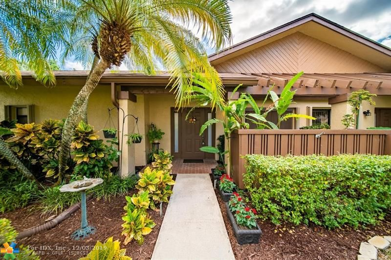 AMAZING TWO BEDROOM VILLA IN KARANDA III.THIS HOME SHOWS  PRIDE OF OWNERSHIP.MRS CLEAN  LIVES HERE.FEATURES INCLUDE, KITCHEN..COMPLETELY REDONE,ALL NEW APPLIANCES,SOLID WOOD CABINETS,GRANITE COUNTER TOPS ,MARBLE BACKSPLASH , FLOORING IS CHISELD PEWTER.FLOORING IN LIVING AND DINING AREA IS 3/4 INCH ROSEWOOD.A/C AND HURRICANE SHUTTERS ARE LESS THAN 2 YEARS OLD.ALL CIELINGS HAVE  KNOCK DOWN FINISH. MASTER BEDROOM FLOORING IS ALSO 3/4 ROSEWOOD.MASTER BATHROOM  HAS DOUBLE SINKS.WALLS ARE WITH VASOR PAINT,EGGSHELL FINISH.BOTH BATHROOMS REDONE,GUEST BATHROOM SINK IS A STAND ALONE. WALLS ARE A POLISHED MARBLE. OUTSIDE HAS GUTTER OVER FRONT DOOR AND SUPER GUTTERS ON ATRIUM. AMENITIES INCLUDE CLUBHOUSE,TWO STORY GYM,SAUNA AND MUCH MORE. GREAT LOCATION ! CLOSE TO ALL MAJOR HIGHWAYS AND SHOPPING.
