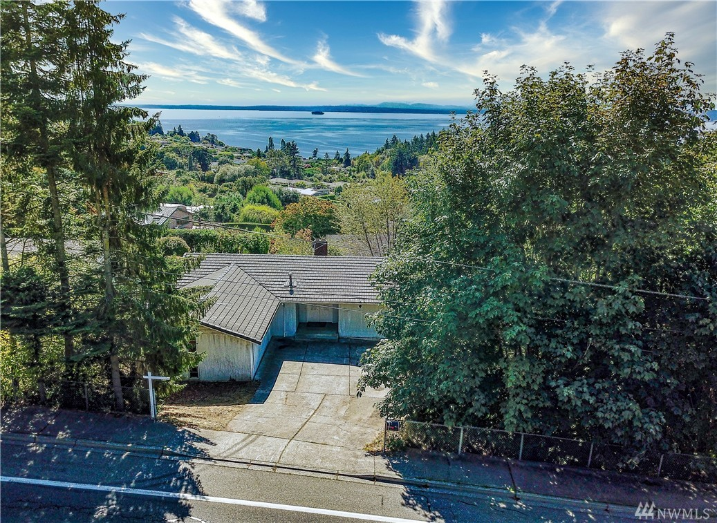 Great opportunity to own a view home in Richmond Beach. This level entry with a basement features GREAT VIEWS from both floors. This house needs some fixing up and updating but has all the potential to be a spectacular Richmond Beach VIEW home. The driveway is somewhat steep and cars that ride low to the ground will scrape the ground hard. The garage door will be left open to use as a turn around to exit.