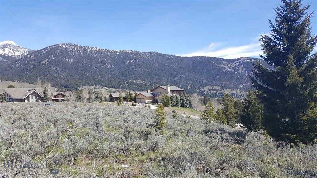 "A large 1/2 +/­- acre building lot in the heart of Big Sky's Meadow Village. This is an elevated corner building site in ""Looking Glass"" with a stunning top of the world views North toward the Spanish Peaks and southeast to the Golf Course. Big Sky Sewer and Water District. Convenient location and within close proximity to the new Town Center for dining, concerts, movies and more."