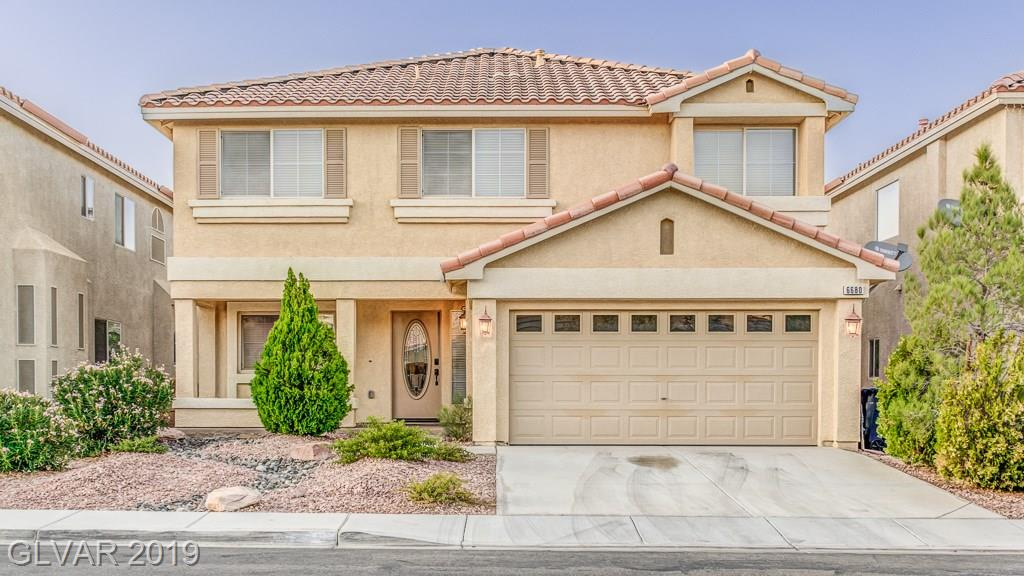 FANTASTIC 2 STORY 4 BEDROOM HOME ~ PLENTY OF STORAGE IN THE KITCHEN WITH TILE BLACKSPLASH ~ BUILT IN HUTCH IN DINING ROOM ~ EASY CARE YARD ~ HOUSE IS ON A DEAD END STREET ~  MINUTES FROM THE STRIP AND NEW STADIUM ~