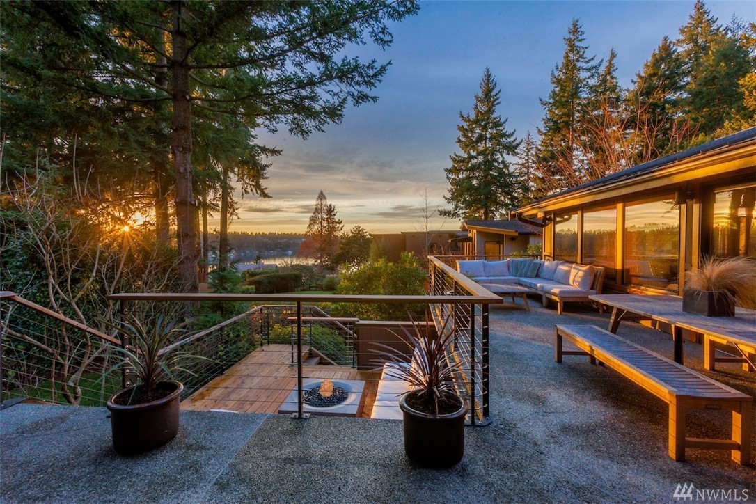 View Property! Take in expansive Pacific Northwest views as part of Killarney Circle's intimate neighborhood from this classic West Bellevue home, distinguished by premium materials, open floor plan, and remarkable attention to detail. Vaulted ceilings, exposed timbers, and sculptural elements complement an ergonomic flow. Multiple view-oriented spaces offer flexible options for living and entertaining, inside and out. A deluxe chef's kitchen and private master suite define hearth and home.