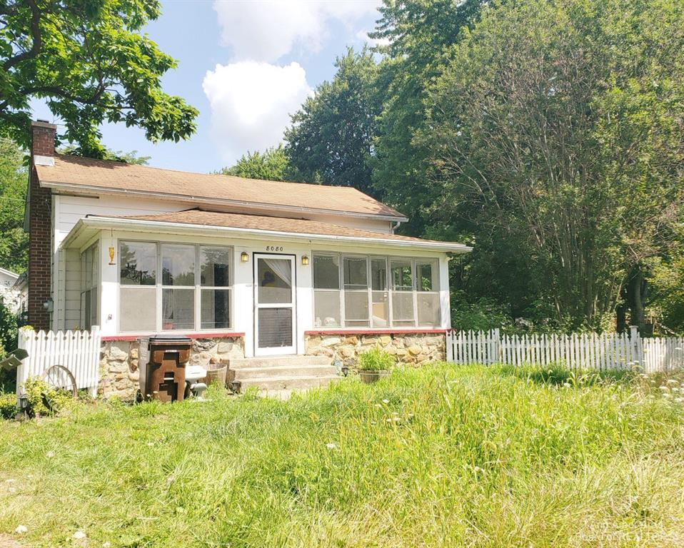 This charming 1800's bungalow is a perfect fit for those looking to tap into their creative side! Located in historic Macon Township, you'll love everything this yard has to offer; raspberries, blackberries, peonies, hydrangeas, garden, compost, stone fire pit, white picket fence. You'll love the outdoor studio/she-shed, ready for you to unleash your artsy interests. The home has original hardwood flooring in the 1st Floor Bedroom, Living & Dining Rooms. The 2nd story offers the opportunity to create a 3rd bedroom. Clawfoot Tub and skylight in the bathroom create the perfect space to unwind after a day of gardening! The enclosed front porch is ready for you to enjoy the starry summer nights. Mud Room off the kitchen is an opportunity to create a 1st floor laundry room, and is just a step away from the Garage with perks. The 2car garage has a spot for your heating/cooling wall unit, a workshop area that includes a hidden fold-out bar top, and an additional lean-to off the back of the wo