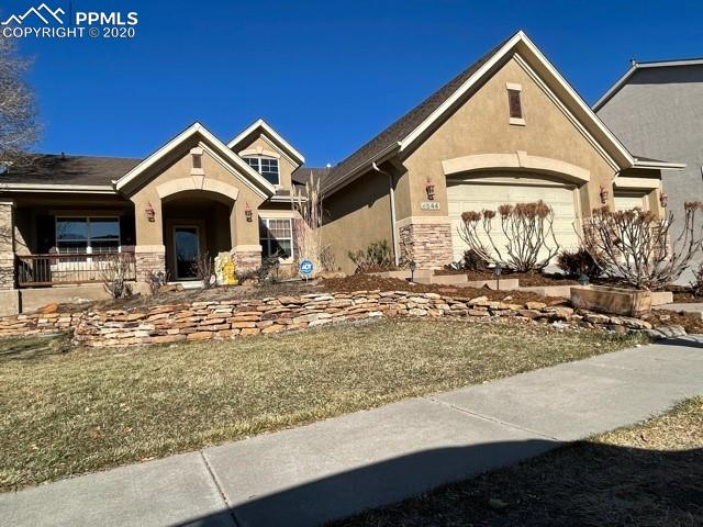 This spectacular home (the largest ranch home in the neighborhood) has many designer touches with glorious light and openness. Pass the pond on your way into this home to enjoy a welcoming front porch with wrought iron design and stained glass front door. Enter with the formal dining area on the right leading to an open, splendid home with cathedral ceilings and a stacked stone fireplace. **** A large Victorian style grand mirror is mounted on the main wall, adding grace and elegance to the home. **** A large open kitchen offers granite tile surface with a breakfast bar and a large pantry. ***  The south wing has 2 comfy (with added designer paint feature in each one) bedrooms, and a full tiled bath. The owner's suite, on the north wing, has a large bedroom, spacious 5 piece bath with an enormous deep tub and separate shower rounding it off with a huge walk-in closet. The laundry room on the main floor leads to the garage and has a mud area, utility sink and closet. *** The wide staircase to the basement has a safety feature with built-in lights. Enter the spectacular garden level basement with wet bar, room for a pool table and a theatre room with projector and sound system. One of the greatest features of this home is the storage area with lots of room for your storage needs. *** Two more bedrooms and a full tiled bath are in the basement area. There is a small room right off the family room which could make for a play area or study area.*** Enjoy the outdoors on the large deck or step down to the oversized patio for more entertainment space. A hot tub would be an impressive addition to the lower deck area.