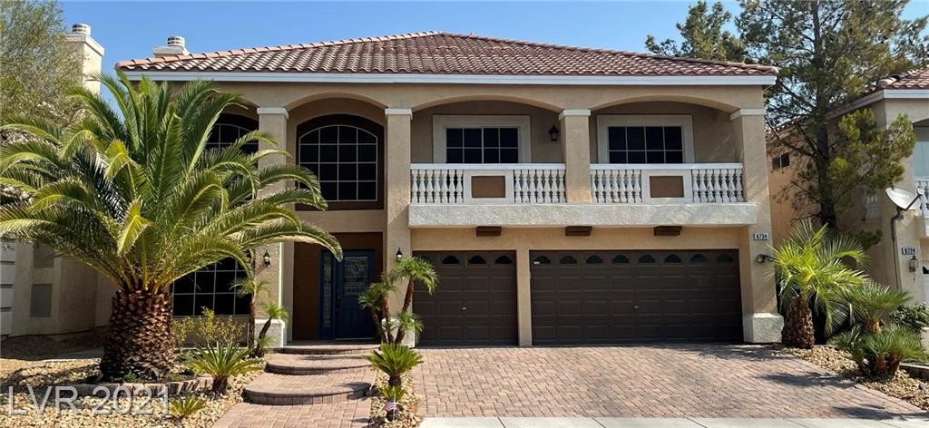 This gorgeous two-story home has many desirable upgrades. From the large vaulted entrance with stone flooring, crown molding, and fireplace to the outdoor kitchen with stone counter tops and TV, next to the cool blue swimming pool, there is plenty of room for the whole family to enjoy. Large rooms for entertaining your friends and guests, beautiful kitchen & island with lots of storage space, upgraded bathrooms, hardwood baseboards, balcony in the back overlooking the pool and a balcony in the front great for watching the fireworks on the Fourth of July! Situated near lots of shopping, schools, easy freeway access to the strip or the airport, this home is sure to go fast!
