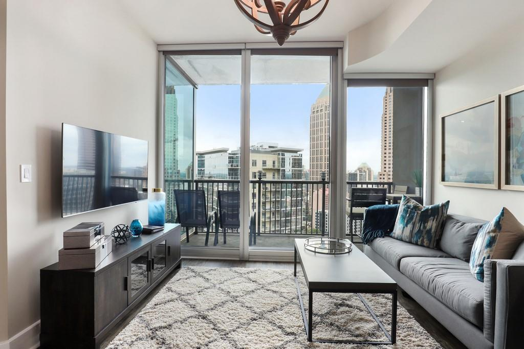 BEST PRICE ONE BEDROOM UNIT ON HIGHER FLOOR. RARE OPPORTUNITY! Experience luxury living in the heart of Midtown. Enjoy views of Midtown skyscrapers from your 21st floor balcony. Unit provides an oversized bathroom & large walk-in closet. In the last two years, Seller has upgraded: HV/AC, Hot Water Heater, Luxury Laminate Hardwoods, & added automated shades in the Primary Suite. Community features include: Rooftop Pool, fitness center, 24 hour concierge, Zen gardens. Steps away from Piedmont Park & the incredible restaurants of Midtown.