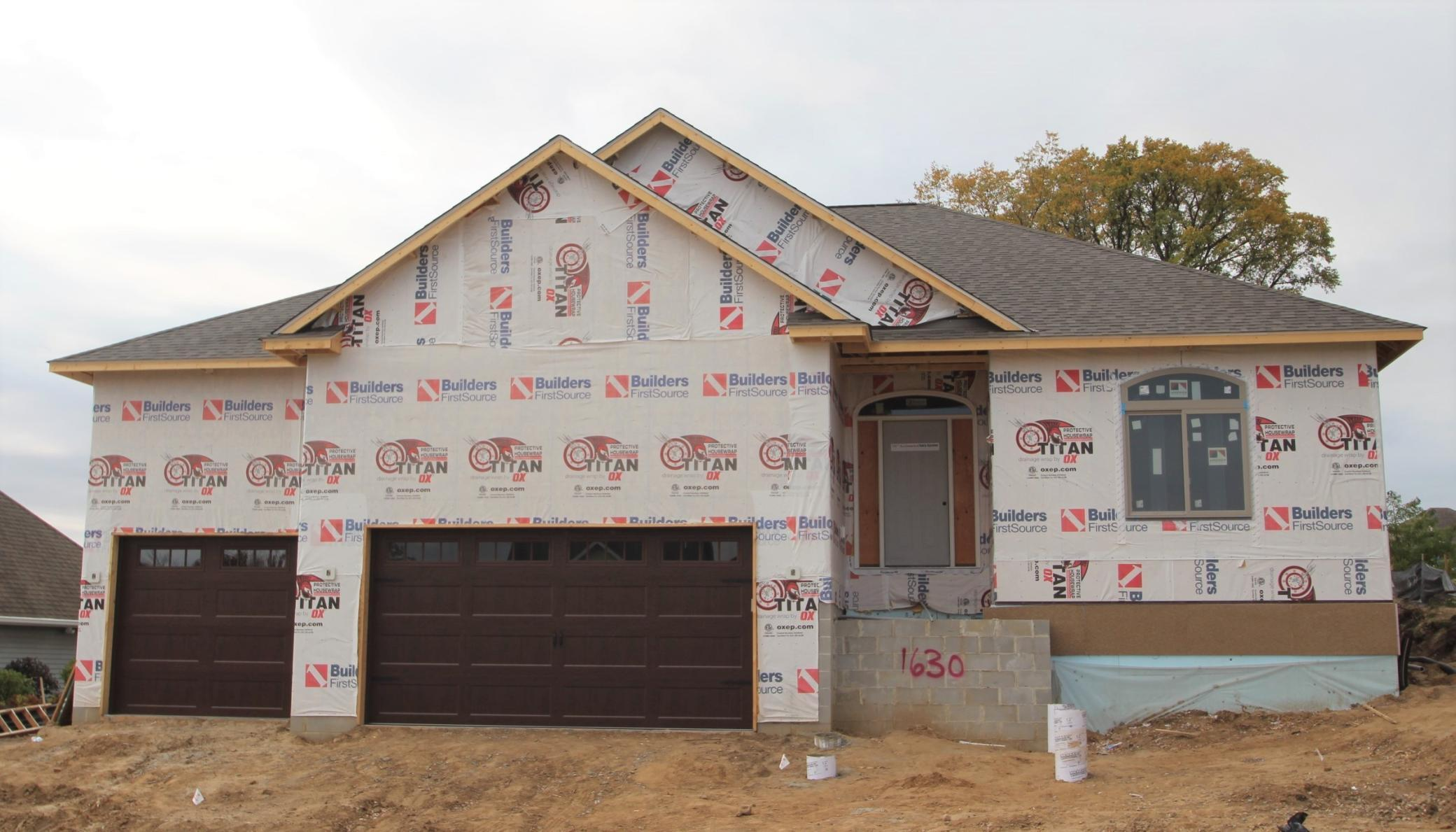 This attractive home now under construction in Southwood Heights offers sharp curb appeal and high-end amenities. THERE IS STILL TIME FOR YOU TO PICK INTERIOR SELECTIONS AND BE IN BY DECEMBER 1. The open great room features a kitchen with large center island and granite or quartz tops. The living room has a corner gas fireplace. The master suite boasts two walk-in closets and a beautiful private bath with heated floor, separate vanities with makeup counter, tile walk-in-shower and a separate water closet. There is a den or second bedroom at the front of the home with two closets as well. The main floor laundry has cabinets with a sink. Downstairs are two additional bedrooms and an enormous family room. The basement offers rough ins for future theater, wet bar and sauna. The home will offer Cat 5 wiring, and an intercom and sound system. The garage is insulated and roughed in for heat. The exterior is LP Smart Siding with cultured stone and the yard will be finished and sprinkled.