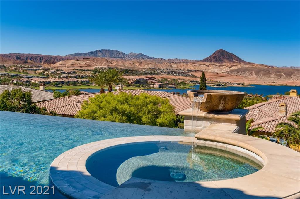 BREATHTAKING Beauty from your first step into this STUNNING single story Masterpiece. Spectacular Lake Las Vegas and Mountain Views. Open Great Room design.  Remodeled from the studs in 2015. Steel Double Door Gated Entry into Courtyard w/fireplace, Italian Limestone flooring, floor to ceiling glass doors, custom architectural ceiling details w/soffit cove up lights. Smart Home technology: Sonos, Lutron, NEST WIFI & ACS, Security System, Monitoring and Cameras. Fabulous Gourmet Kitchen features Double Islands-Slab granite, Wolf & Subzero stainless steel appliances, steam oven, built in Espresso maker. Marvel at the Illuminated Onyx Wine/Martini Bar. PERFECT for Entertaining at Backyard Wood Mountain style custom Covered Patio, Outdoor Kitchen, BBQ Grill/Bar, Fire Lounge or simply Relax and Enjoy your Infinity Edge Pool & Spa with the soothing sound of fountain spillovers.  Primary Suite, sitting area, custom wardrobe closets, radiant heated floors in primary spa bath. EXUDING QUALITY