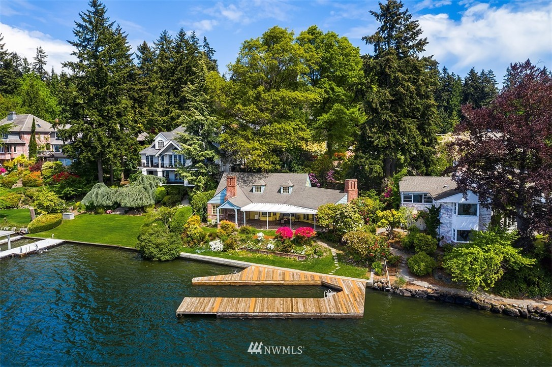 On the market for the very first time, Lake Washington dazzles from this west/north-facing waterfront opportunity in Enatai. Bring your vision for this 19,090 sq ft lot with 80 feet of waterfront and dock which can accommodate multiple watercraft including yachts up to 45 feet. Spend glorious summers lakeside; the flat lot invites the indoor/outdoor waterfront lifestyle. Two existing structures include the 3,260 sq ft main house, a one-bedroom cabin, and a detached 2-car garage. Incredible views of the lake including fiery sunsets. Fabulous Enatai location on a quiet dead-end street close to all of the amenities Bellevue has to offer. A blank canvas awaiting your waterfront dream home.