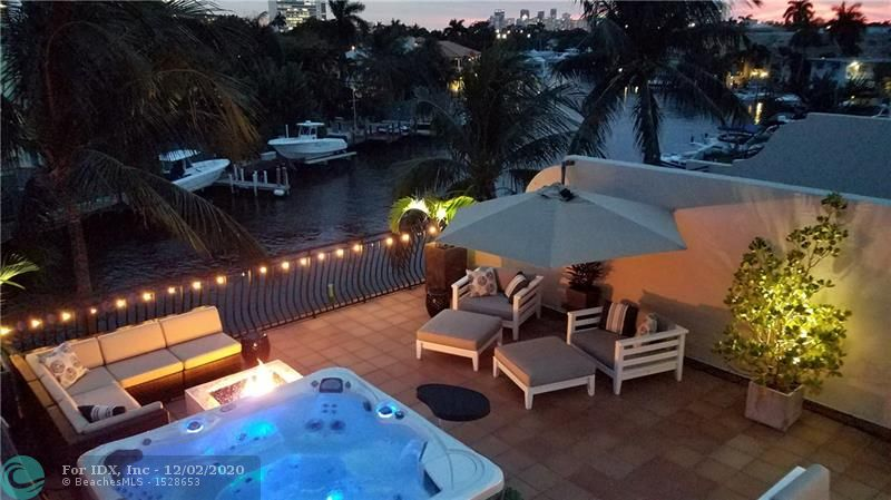 CORAL RIDGE WATERFRONT townhome with assigned boat slip up to 34' ft. (50 amp power/water) on deep water canal right off intercoastal waterway, no fixed bridges. Beautifully appointed (3,415 sq ft) 3BD/2BA +2 half baths, master suite/bedroom w/balconies. Marble master bath w/whirlpool tub, separate shower. Impact windows/doors. Spectacular private rooftop terrace w/outdoor kitchen, dishwasher, ice maker & spa completely set up for outdoor living . Fully furnished option available. 2 car garage. Backup electric generator incl.. Whole house/outdoor Sonos/Bose system incl. Smart home features. Custom made 23' long one of a kind Shakuff Chandelier.