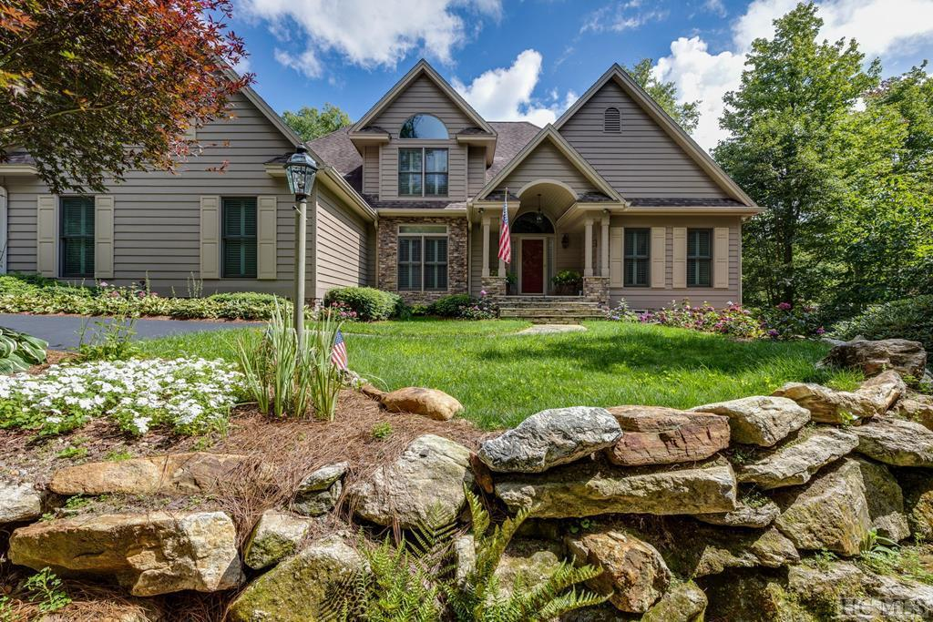 Located inside the popular community of Cullasaja Club located half-way between Highlands and Cashiers, this family retreat is introduced to the market for the very first time. Custom built with high-quality construction for one family who have enjoyed it, your family has the opportunity to create lasting memories in this special estate. This charming home sits quietly on a cul-de-sac with a mountain stream on your border. Mature landscaping creates inviting curb appeal as you approach the home with plenty of parking area for family and friends. One level living is possible with the primary bedroom and a guest suite on the main level with a cozy den, great room with vaulted ceilings, dining area, kitchen and breakfast area. The laundry room and two car garage are short distance from the kitchen. The beautiful great room with a large stone fireplace opens to a private screened porch that opens to a large deck overlooking the stream. The upper level has three spacious bedrooms sharing a hall bath. Two large storage areas are on each side of the upper level which can be finished for another bathroom or extra living space. The terrace level provides a warm and comfortable suite complete with a full kitchen, a great room with a stone fireplace, a bedroom suite, a media area, an office and a pool table room. The golf cart garage is on this level with additional walk-in storage. Located close to the gate of Cullasaja Club and walking distance to the yacht club which gives you access to Lake Ravenel for boating, fishing, kayaking and paddle-boarding. Upon invitation and for an initiation fee, you can enjoy the many amenities of popular Cullasaja Club including an Arnold Palmer golf course, a newly remodeled clubhouse with several dining venues, a fitness complex with a heated pool, tennis courts, fitness center, croquet lawns, a playground and practice range. Due to limited inventory, this home will not last long on the market.