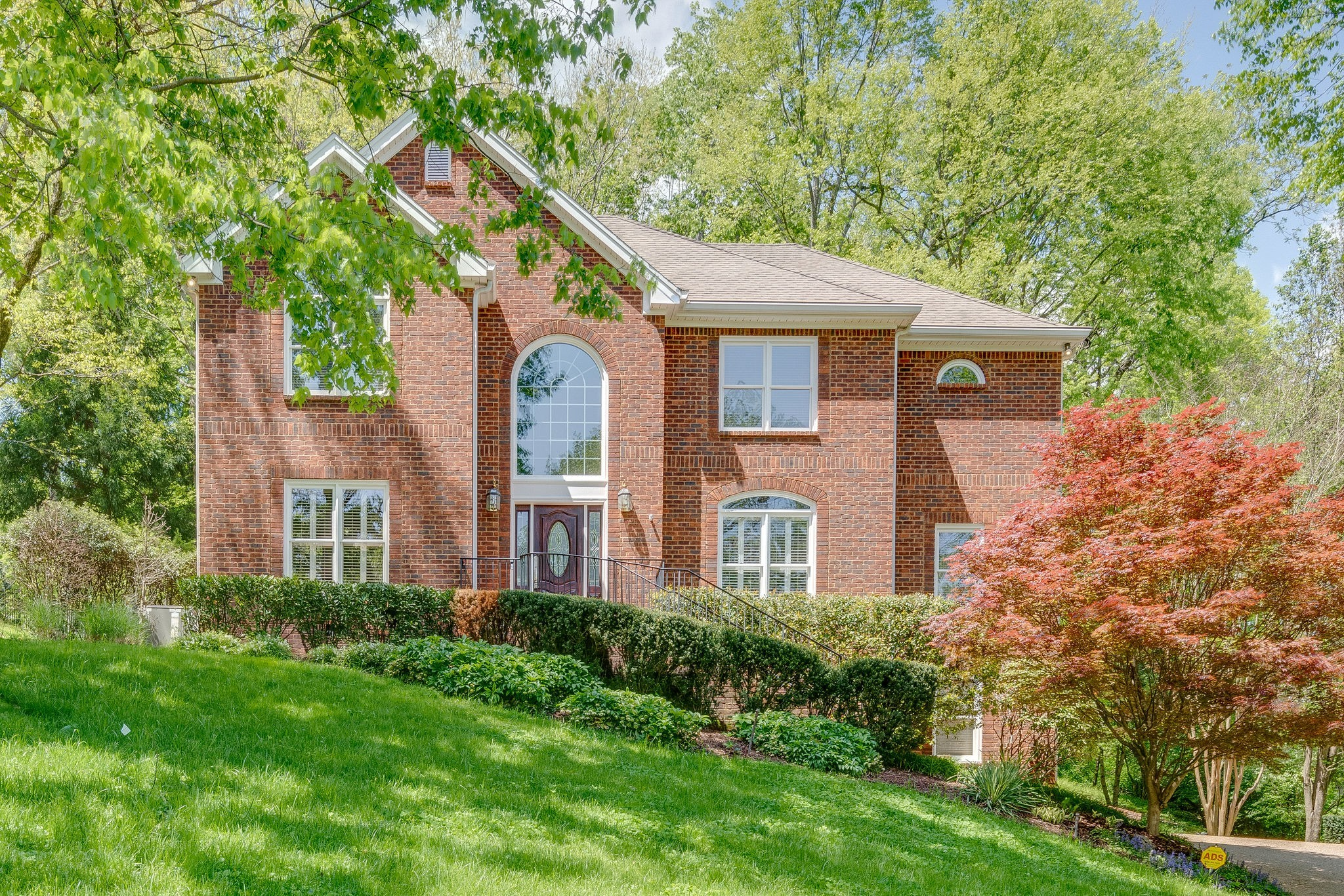 HOME BACKS TO 11th HOLE BEHIND TREES * HARDWOODS THROUGHOUT 1ST FLOOR*FABULOUS 2 STORY DEN * GREAT VIEWS FROM FRONT & BACK! * LOVELY MOULDINGS AND CABINETRY * BACK STAIRS, WET BAR, CUSTOM SILHOUETTE SHADES, BLINDS, SHUTTERS AND FISH POND W/ WATERFALL*MUST SEE!