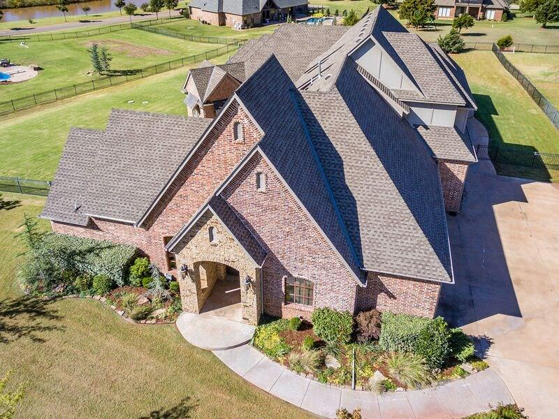 This incredible home offers a detached GUEST HOUSE that adds 538 sq ft that is not reflected in the above sq ftage. Guest home provides large living/bedroom, full bath, kitchenette area & large walk in closet. Unbelievable price for this beautiful home, showing absolute abundance in style & design. Striking, large rooms & soaring ceilings with beautiful fixtures at every turn. This home offers amenities appealing to the most particular with master & second bedroom down and two bedrooms upstairs with large bonus room & workout room. Wood floors in most areas, and a gated wet bar offering a perfect flow for guests or family. A kitchen of ones dreams, boasting cathedral ceilings with rafters & a gorgeous chandelier, huge center island, double ovens, under counter lighting, granite counters & gas cooktop. Addition is gated and has two stocked ponds and walking trails that are enjoyed by all. An exceptional place to call home.