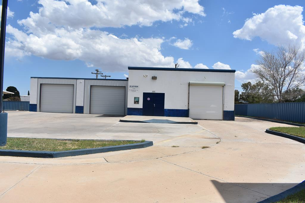 Nice corner lot on almost a Half Acre with Three bays. Use to be a car wash.Plus another area with a door in the  front and back with a bathroom without a sink.  Has covered parking area. Drive around building. So many possibilities for a business. Plenty of parking.