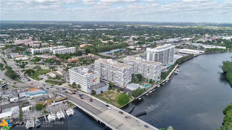 RARE PENTHOUSE UNIT..Completely updated: New Kitchen, Bathrooms, Flooring.. Comes with a coveted assigned COVERED PARKING SPACE conveniently located to outside entry way and elevators. Windows and Doors are hurricane protected.. Views to die for:  Middle River, Intracoastal, Ocean, Downtown Fort Lauderdale Skyline, and In the distance Port Everglades. This much sought  after community includes : Guest parking, Fitness Center, Heated Pool, 24 Hour Security, Sundeck, Card Rooms, Library and All other amenities which you would Desire . Great location convenient to restaurants, movie theater, shopping. This is a ONCE in a lifetime opportunity to own this fabulous PENTHOUSE unit.. Location, Location, Location and priced to sell .. Don't Miss It !!