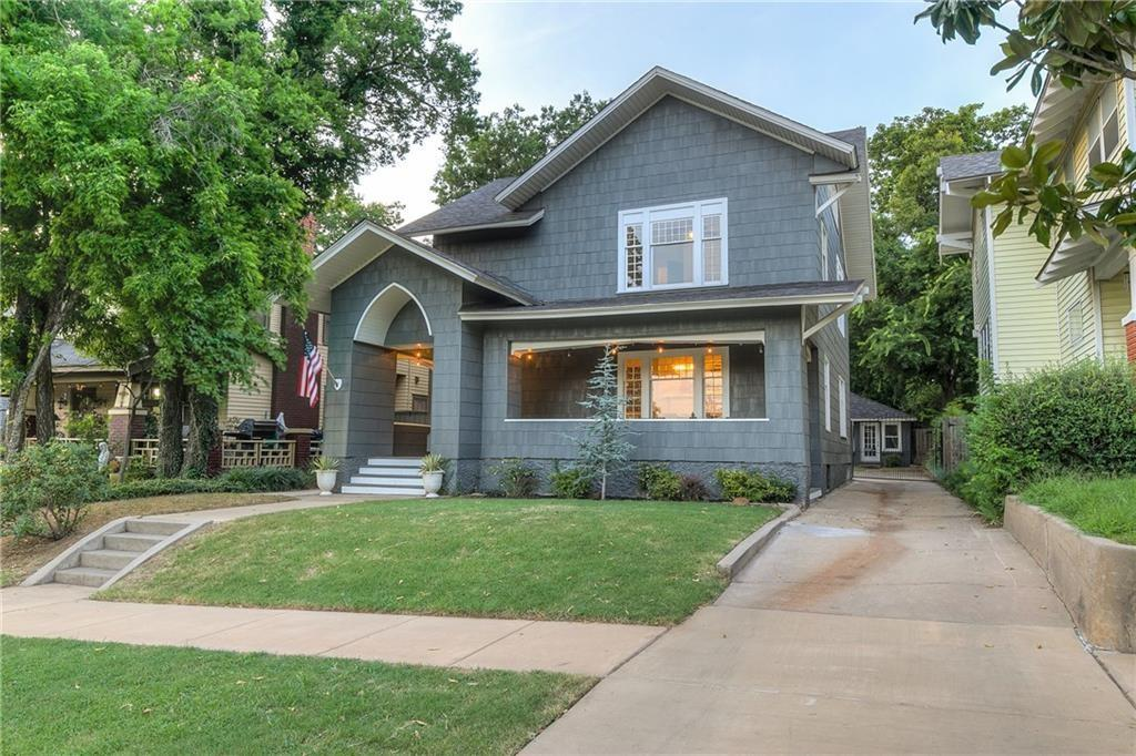 Modern Restoration in Mesta Park. The HEART of OKC living! Lovely street appeal with updated gardens, sod, & a wide welcoming porch perfect for rocking chairs & friendly chats!  First floor welcomes guests with grand staircase, open kitchen, flexible living spaces, powder bath & a gorgeous view of the large back yard & studio/office/homeschooling bonus liv space. Gated parking. 2017 permitted renovations include HVAC, electrical, H2O Heater, roof.  All updated lighting & plumbing. New cabinetry & countertops. Window mechanicals and wood floors restored.  The 2nd floor has 3 bedrooms, full hall bath, laundry (no need to trudge to the basement), & master bath with restored clawfoot tub, separate closets.  3rd story flex space with closets & mini split air. 2017 appliances, refrigerator, w/d included.  See list of full restoration items that makes this home a pleasure to own with all the necessary maintenance done for you.  Short distance to Uptown, Midtown AND the Plaza Districts!