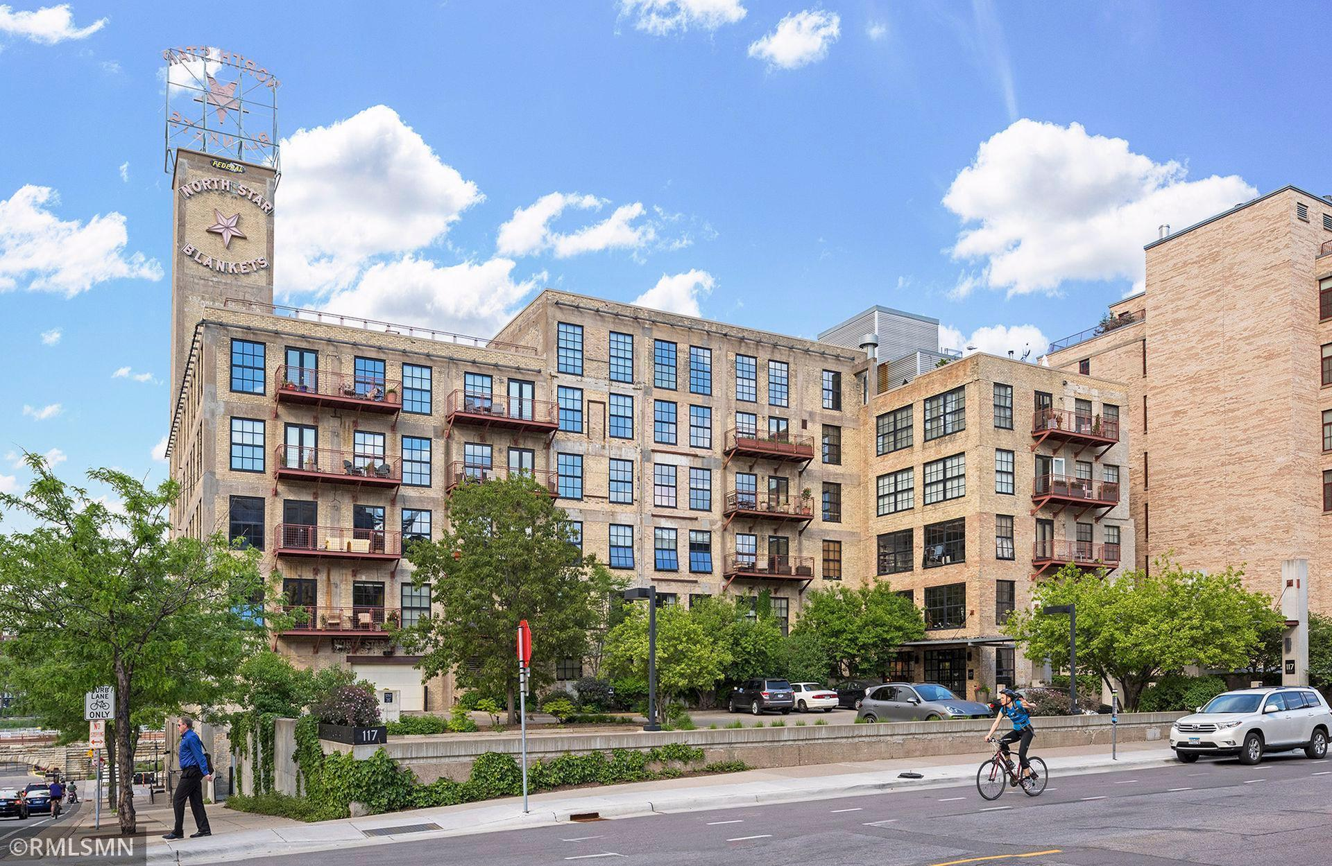 Historic North Star Lofts building in the Mill District. Sunny 6th floor corner loft  - one level living with city skyline AND river views. 4 parking stalls and private rooftop cabana overlooking Stone Arch Bridge. Immaculate condition.  This loft is the epitome of historic charm.