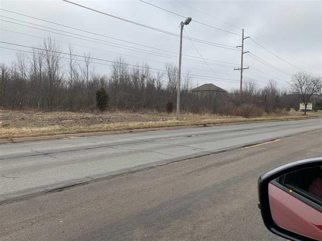 22 total acres zoned commercial Located on Lennon  Excellent opportunity for development,  Build to Suit