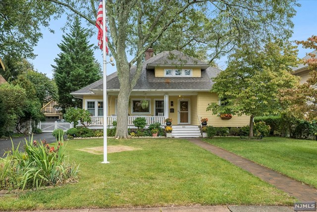"""Key location! Hardwood floors & trim, beautiful accent windows, wood burning fplc, this home is flooded w/warmth & light beginning w/the lemonade porch. Deceptively large, a well planned expansion created the sunlit family room offering radiant heated floors & tray ceiling along w/a stunning kitchen designed by Grainview. Cherry cabinets, Silestone counters, double sinks, & trivection oven are a chef's delight. Cozy office, 2 bedrooms & bath w/jetted tub complete this floor. 2nd level offers complete retreat w/roomy landing, primary bedroom w/skylit alcove, luxurious bath w/double marble sinks & skylights, plus a walk-in closet. Expansive attic offers potential to expand even more. Lower level offers many functions: Game room & wine cellar, generous laundry & work room, plus storage galore! Outdoors the deep backyard is punctuated with perennial gardens & bluestone paths, a paradise for nature lovers. Just steps from Glen Rock downtown, and NYC transportation. Garage sold """"as is"""