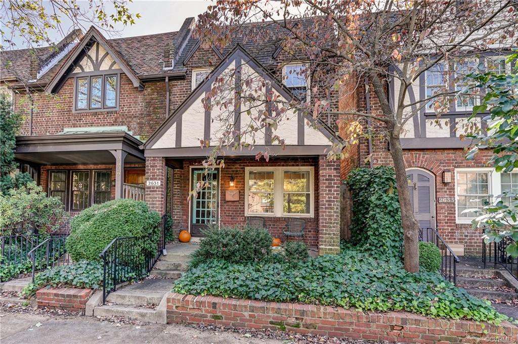 This charming Tudor row house in the heart of The Fan District offers living room, dining room, kitchen with morning room, and laundry on the first floor.  Upstairs has two bedrooms, large walk-in closet and hall bath. Recent upgrades include heat pump and rear roof. This quaint English cottage has rear patio area and great front porch for outdoor living. Ideally located close to museums, restaurants, shopping and all the Fan has to offer. Waiting for your special touches to make this a special home full of character and charm!