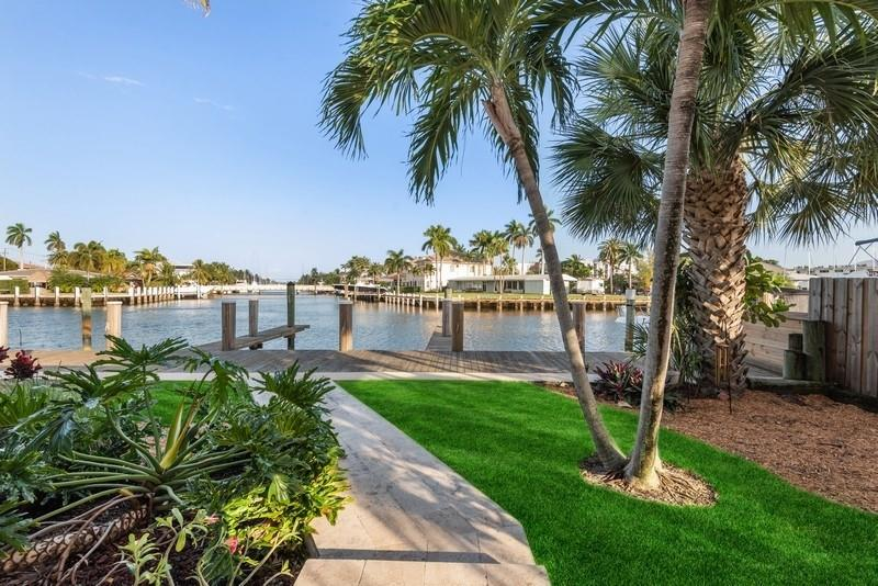 Embrace the tranquil tropical breezes of this ocean access, deep waterfront Lauderdale Harbors residence. This 3 bedroom, 3 bath boaters dream residence features 70 ft of deep water dockage and is positioned with gorgeous water views and ample dockage for multiple boats. Marble floors throughout, luxury baths with spa like features and a chef's premium eat in kitchen with Miele appliances, Miele Induction Cooktop, granite countertops, red birch cabinetry and all the creature comforts of a food lovers kitchen. Master suite features a beautiful veranda to relax and enjoy the South Florida sun. Great location..Just minutes to beach, shops, restaurants and airport.