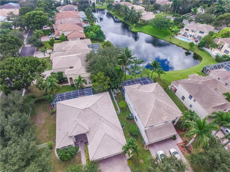 You can have it all!Winston Park neighborhood has top rated schools, parks, newly developed Promenade with world class shopping, dining and entertainment and more. On one of the largest waterfront lots in the community site this large 4bed/2.5bath plus 3car garage home that has a screened-in pool that with views of the lake, large yard, all while offering buyers an outstanding value, with a private gated entrance, quiet tree-lined streets, low monthly association fee, fantastic community amenities including fitness/gym and community pool/rec center, tennis, basketball. A must see for any savvy buyer who wants to make this their home.
