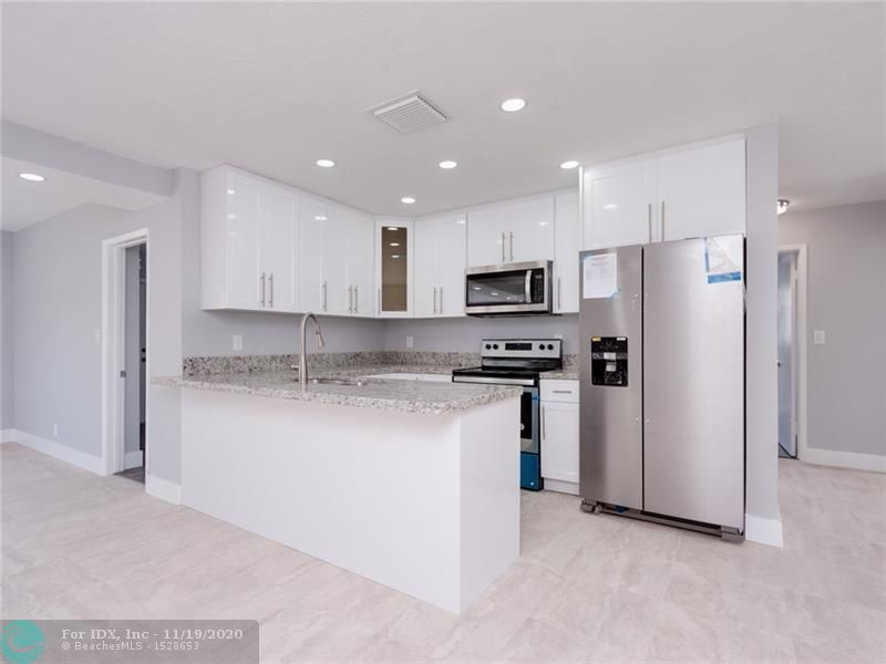 ***PRICED TO SELL*** completely remodeled beauty in the heart of Oakland Park. East of 95 close to the sunny beaches of FT Lauderdale. Everything has been redone. New AC, Electric Panel, Water Heater, Flooring, Kitchen, bathrooms and more. SELLER TO CONTRIBUTE 3% OF PURCHASE PRICE TOWARDS BUYERS CLOSING COSTS.