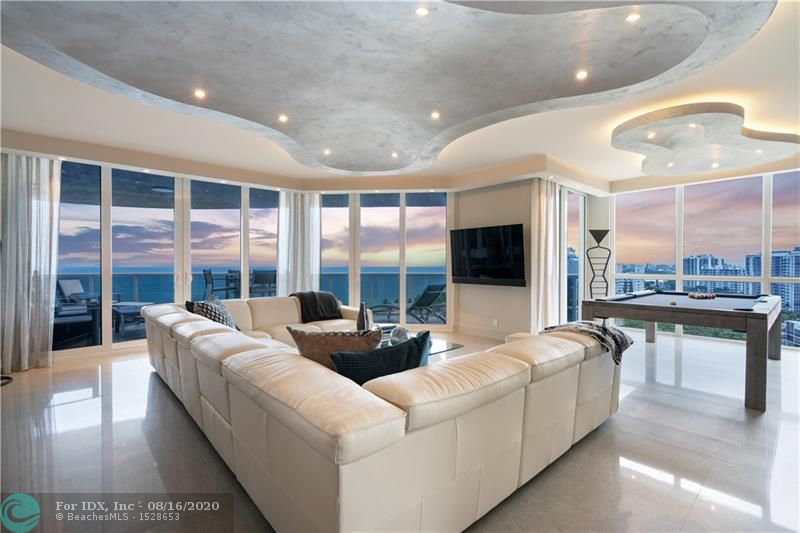 Modern Oceanfront Dream Home. Fully renovated one of kind masterpiece. This unit has 3 separate bedroom suites with large open living space. This Ascot Model was re-architected to take advantage of the wide Southeast coastline views. New High Impact Windows, Large Open Kitchen, water filtration system, smart system to control sound, lights, blinds, and thermostats. Two brand new AC units and water heaters. Frameless solid doors, custom bar area with refrigeration drawers, finished large closets, and much more. L'Hermitage is over 10 acres of beachfront resort-like property with clay tennis courts, full valet, concierge, spas, massage rooms, steam, sauna, fitness center, café at pool deck, attended beach, dog walk, pool room, child play room, card room, catering hall, much more. Must see!