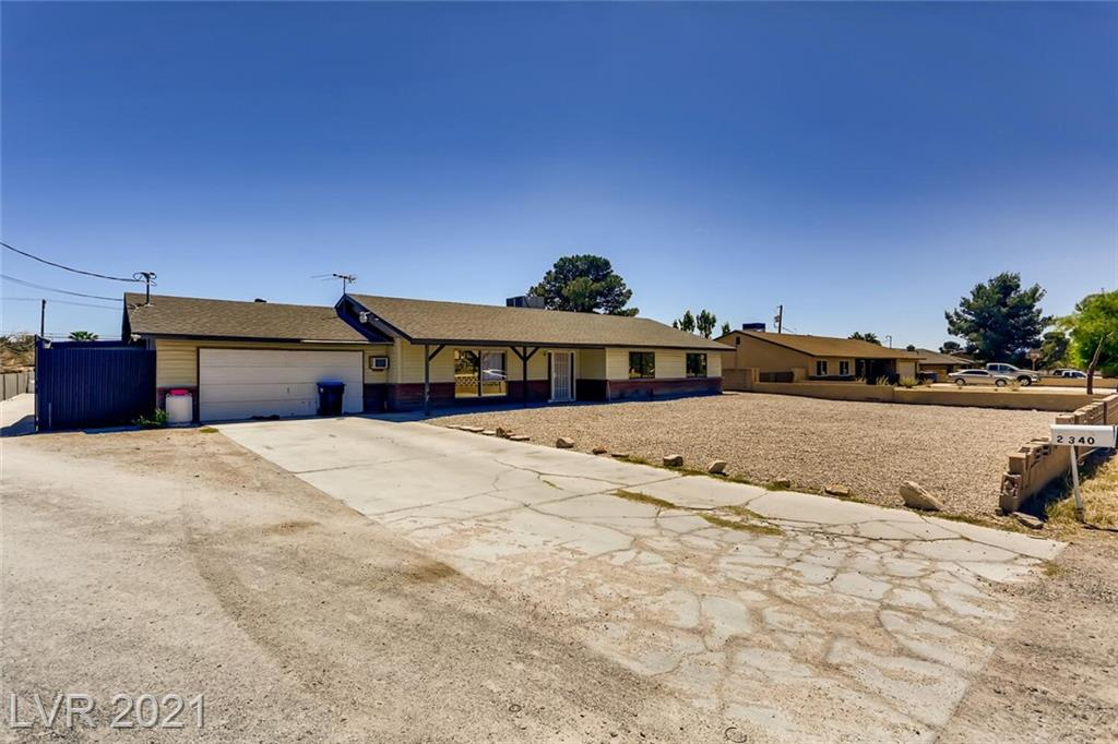 Great home on huge lot with plenty of parking! Three bedrooms and two full bathrooms as well as a detached workshop.