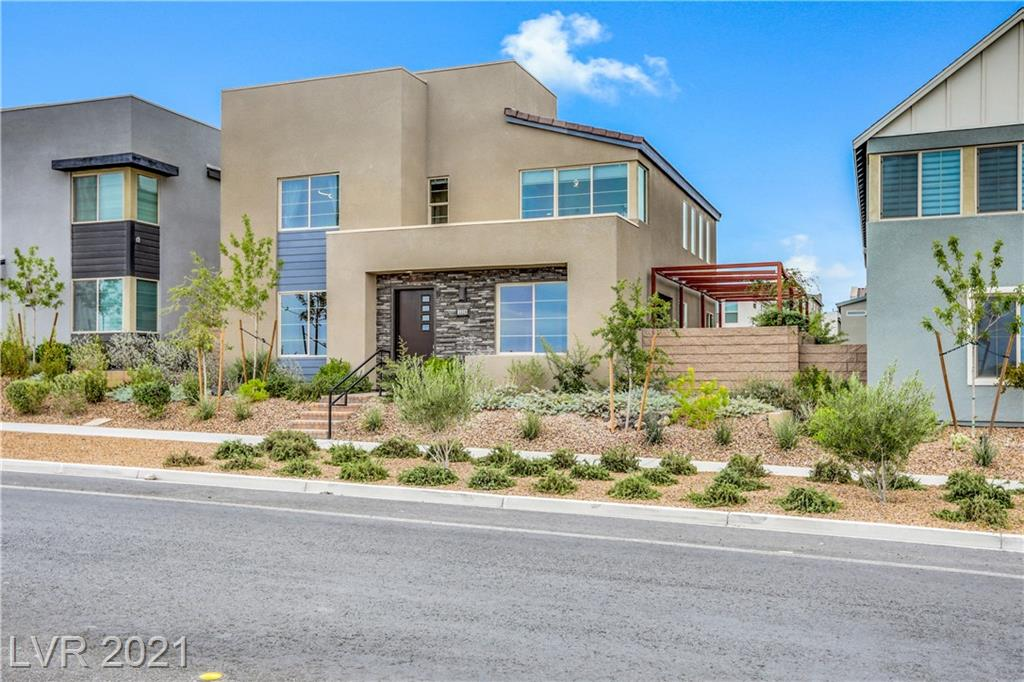 Gorgeous (3-yr new) Inspirada Dream Home. This amazing 4Bd, 3.5Ba (3110 sq.ft) TriPoint home is beautifully designed & appointed inside & out. The modern, luxury, open-concept Strada floor-plan offers many living space options. Unique double front door access opens to covered patio area w/multiple large slider doors to a side yard entertainment area that includes landscape arbor, water feature, paver deck area, BBQ & fire pit areas. Rear street & garage access offers extra parking space. Tons of interior features & upgrades include tile flooring, quartz countertops in kitchen & bathrooms, upgraded CAFE SS appliances, tile backsplash, walk-in pantry, mud-room area, oversized upstair loft area, large bedrooms, upgraded plumbing features, upgraded walk-in shower, soaker tub & walk-in closet in primary bedroom. Backlit bathroom mirrors, custom light fixtures throughout, custom window coverings & motorized shades. The entire home shows like a model & is in perfect, move-in ready condition.